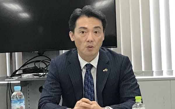 今後の事業を説明する神明HDの藤尾益雄社長(22日、神戸市)