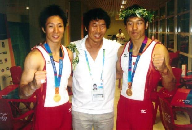 アテネ五輪・体操の金メダル選手と(左から米田功氏、本人、現・男子代表監督の水鳥寿思氏)