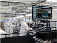 NECプラットフォームズが製造業向けに販売するシステム「生産情報可視化集計システム」の導入例(画面右上)