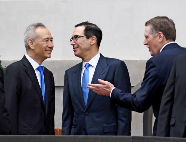 米中の閣僚級貿易協議が上海で開かれるのは初めて(写真は5月のワシントンでの協議)=ロイター