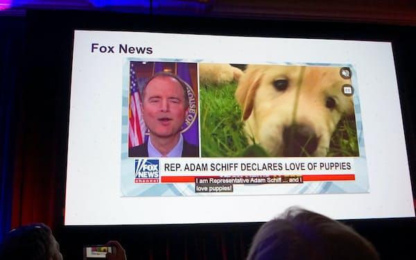 イベントで映し出された、偽画像(ディープフェイク)のニュース(8日、米ラスベガス)