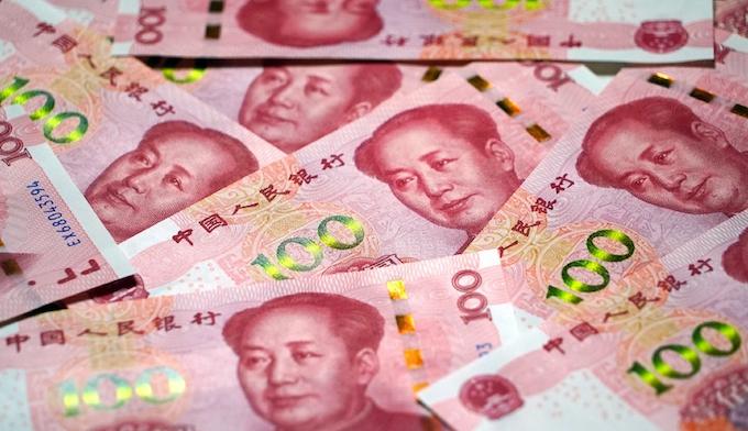 人民元基準値10日ぶり反発 1ドル=7.0312元: 日本経済新聞