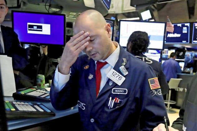米株式市場は米中貿易戦争の世界経済への影響に気をもむ=AP