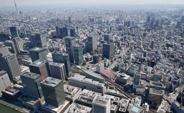 米中摩擦などを背景に、世界景気に対する経営者の警戒感が広がってきた(東京丸の内・有楽町のビル街)