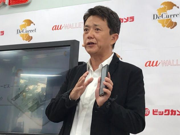 「仮想通貨を通常の決済の中で使えることを実現する」と語る時田社長(21日午前、東京・千代田)