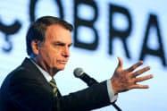 ブラジルのボルソナロ大統領は地球温暖化に懐疑的な態度で知られる(21日、ブラジリア)=ロイター