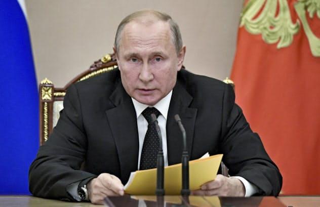 23日、モスクワでの安全保障会議で発言するロシアのプーチン大統領=AP
