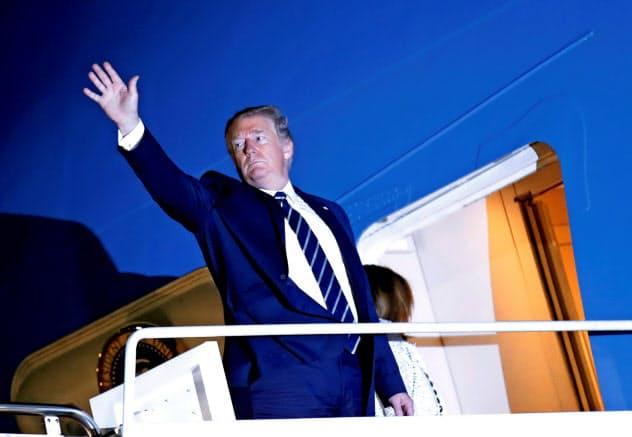 G7サミットへ出発するトランプ米大統領(23日)=ロイター