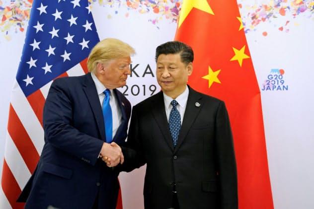 米中の関税報復合戦がエスカレートしている(6月、大阪での米中首脳会談)=ロイター