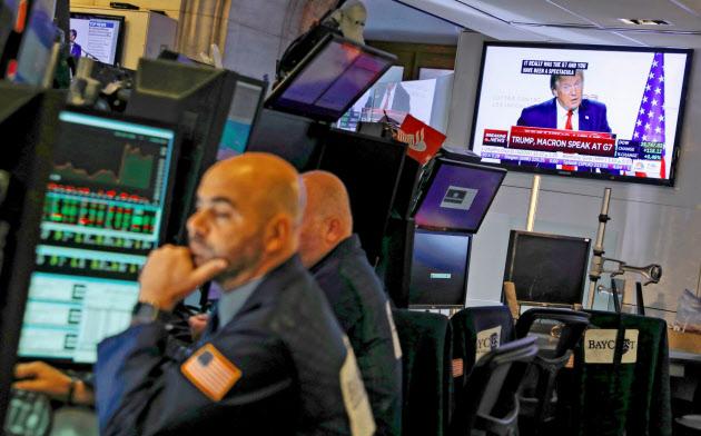 米株市場はトランプ氏の発言に振り回された(26日、ニューヨーク証券取引所)=ロイター