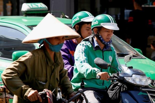 グラブはベトナムの小都市にも進出地域を広げる計画だ=ロイター