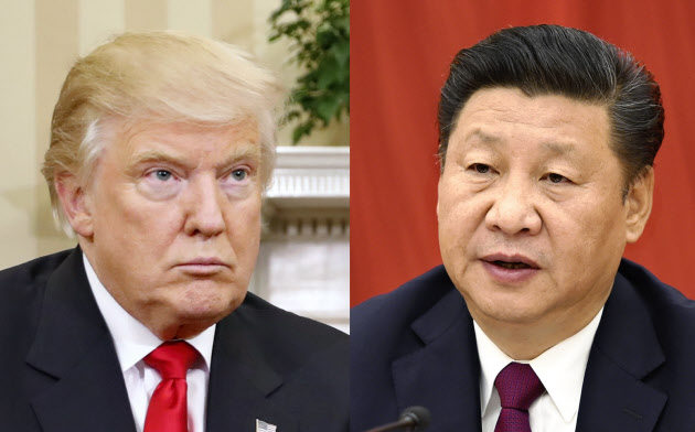 習近平中国国家主席(写真右)とトランプ米大統領=AP