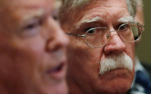 U.S. President Donald Trump receives a briefing from senior military leadership accompanied by his new National Security Adviser John Bolton at the Cabinet Room of the White House in Washington, DC, U.S. April 9, 2018. REUTERS/Carlos Barria - RC18C0E5C350