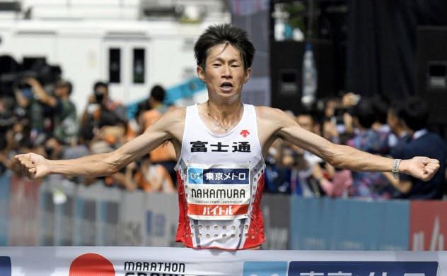 MGCの男子で優勝した中村匠吾。終盤、3選手によるデッドヒートは圧巻だった=共同