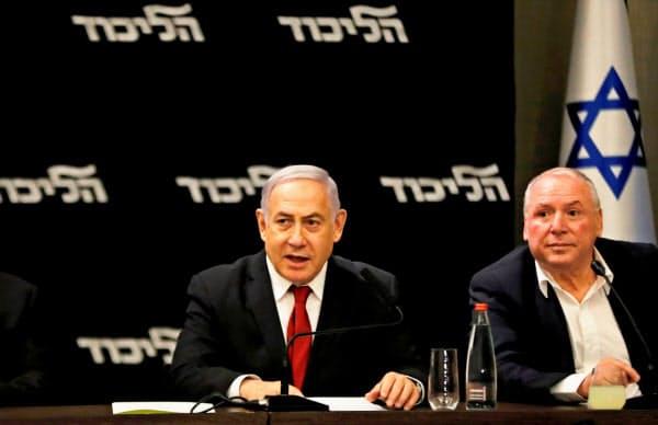 イスラエルのネタニヤフ首相は続投に向けて、ライバルの中道野党連合「青と白」に連立を呼びかけた=ロイター
