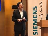 事業戦略について説明するシーメンス日本法人の藤田研一社長兼CEO