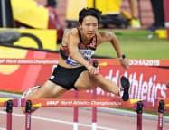 女子100メートル障害予選 力走する寺田明日香(5日、ドーハ)=共同