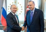 9月16日にアンカラで会談したプーチン・ロシア大統領(左)とエルドアン・トルコ大統領=ロイター