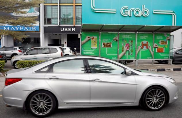 グラブはマレーシア配車市場で圧倒的な存在感=ロイター