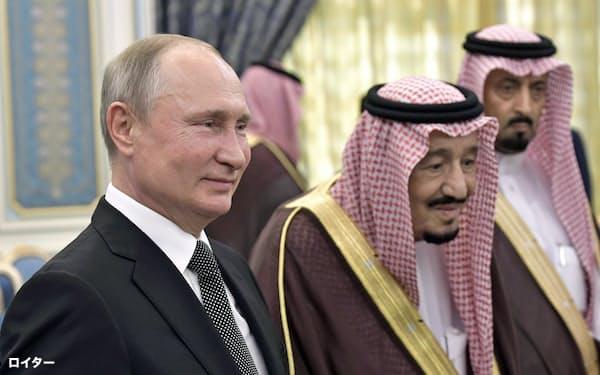 14日、プーチン大統領はサウジのサルマン国王と会談し、関係強化に意欲を示した(リヤド)=ロイター