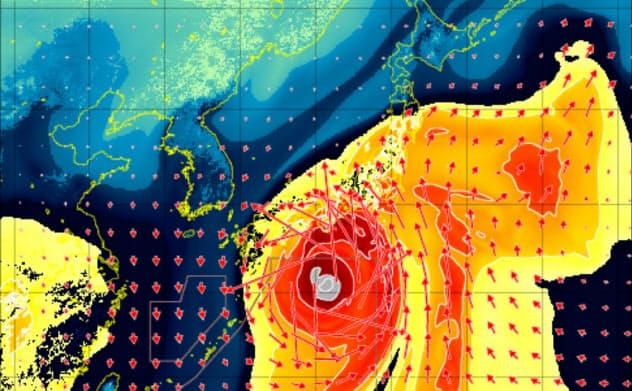 台風19号の東側には「大気の川」の呼ばれる水蒸気の流れがみられた(色の濃さは水蒸気量、矢印は流れの向きと強さ。11日午後9時。坪木和久・名古屋大教授提供)