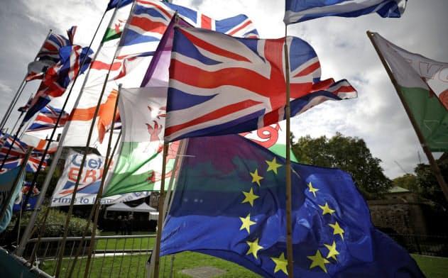 英・EU、離脱条件で合意 英議会承認は不透明
