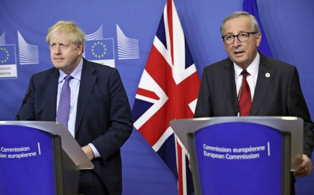英・EU、離脱条件修正で合意 英議会承認は不透明