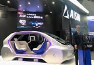 アイシン精機は2020年にEV向け駆動装置を量産すると発表した(23日、東京・江東)