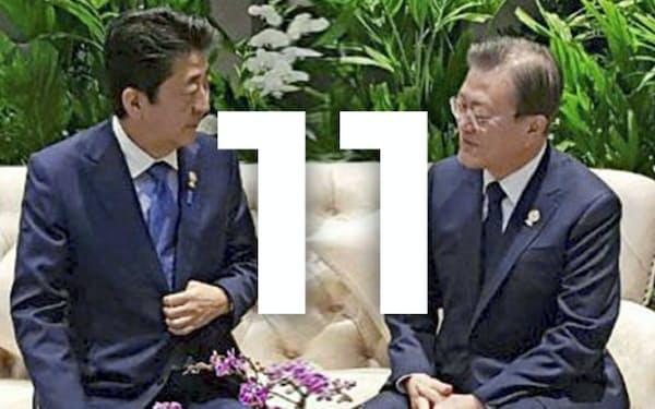 写真は韓国大統領府提供・共同