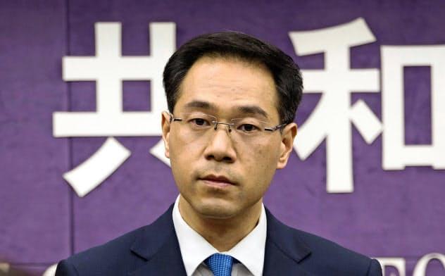 中国商務省の高峰報道官は記者会見で、米中両国は追加関税の段階撤廃で一致したと明かした=AP
