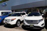 10月は米自動車販売店の売り上げが伸びた(米ニューヨークの自動車販売店)=ロイター