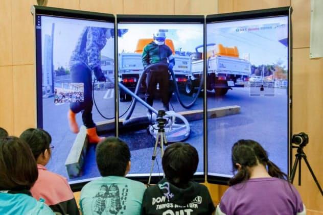 凸版印刷の遠隔校外学習サービスのイメージ。教室にいながら遠隔地の映像をリアルタイムで視聴できる