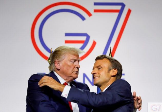 米仏は8月のG7首脳会議で一定の合意に達したが……=ロイター