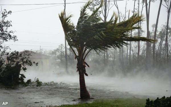 温暖化で浸水や洪水の甚大な被害が増えるとされる=AP