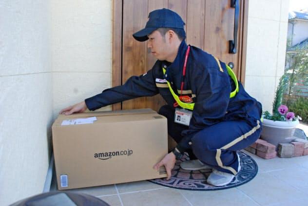 アマゾン、全国で「置き配」 日本郵便と20年に