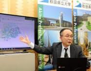 インフルエンザウイルスの進化を予測できるようになると説明する秋田県立大学の小西智一准教授(12日、秋田県庁)