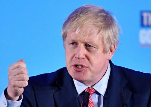 ジョンソン首相は総選挙大勝を受け、1月末のEU離脱の実現を改めて強調した(13日、ロンドン)=ロイター