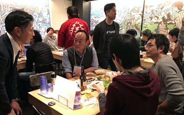 「大阪王将」運営会社は資金調達に応募した投資家向けに試食会を開催(14日、東京・千代田)