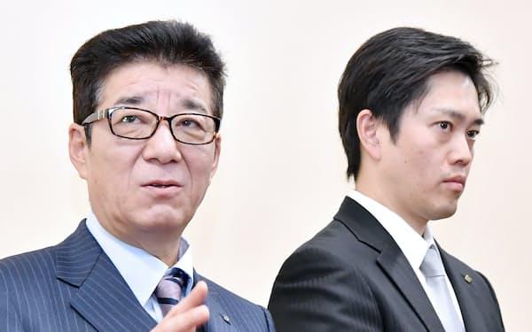 「大阪都構想」の制度案の大枠が了承され、記者の質問に答える松井大阪市長(左)と吉村大阪府知事(26日、大阪府庁)