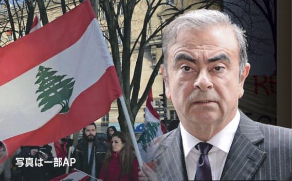 森法相は出入国在留管理庁に対し、関係省庁と連携して出国手続きを厳格化するよう指示した(ゴーン被告とレバノン国旗)