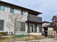 西日本豪雨で被災した自宅を修繕した中西冨美子さん(2019年12月、岡山県倉敷市真備町地区)=共同