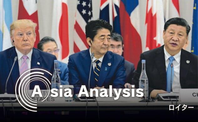 米国との貿易摩擦で、中国企業は日本の後を追うようにアジアへの生産移管を加速する(2019年6月、大阪でのG20サミットに臨む日米中首脳)=ロイター