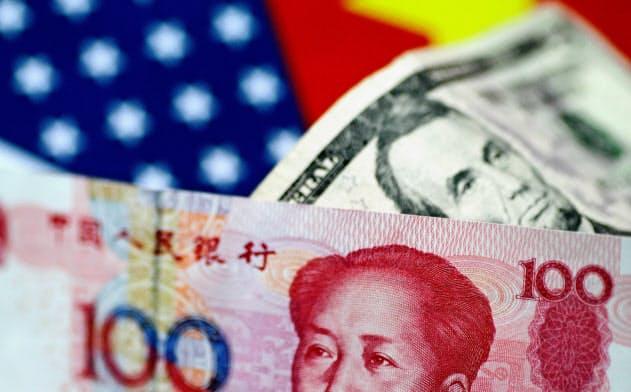 米中両国の通貨摩擦の懸念が和らげば、目先の外国為替市場の安定材料になる=ロイター