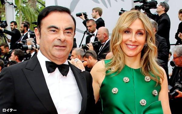 カルロス・ゴーン元会長(左)と妻のキャロル容疑者(2017年5月、フランス・カンヌ)=ロイター