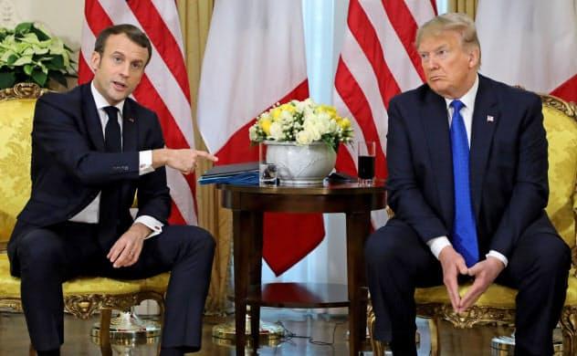 米仏は外交での衝突回避を優先した(19年12月、ロンドン)=ロイター
