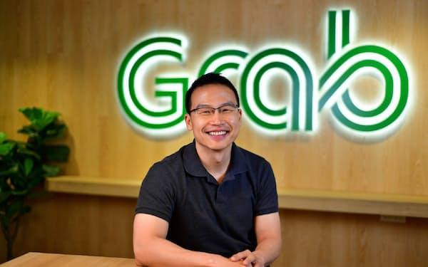 電話インタビューに応じた、シンガポール配車大手グラブのミン・マー社長