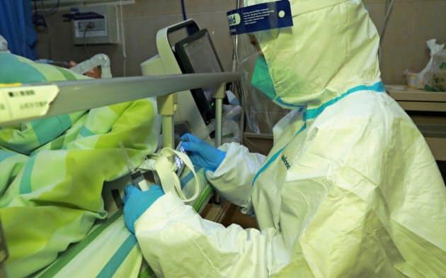 中国湖北省武漢市で発生した新型コロナウイルスによる肺炎感染の拡大が、米相場でも意識された(22日、中国・武漢市)=ロイター