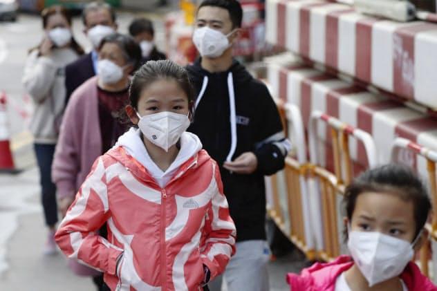 香港では新型肺炎に警戒感が高まっている(26日)=AP