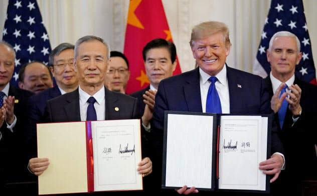 米中が15日、署名した米中貿易交渉「第1弾の合意」で中国が米国に約束した輸入の急拡大は世界貿易にゆがみをもたらすと指摘される=ロイター