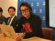 ぐるなび開発部エンジニアリングセクションの岩本俊明副セクション長(写真右)